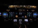 Boeing 737 cockpit at night